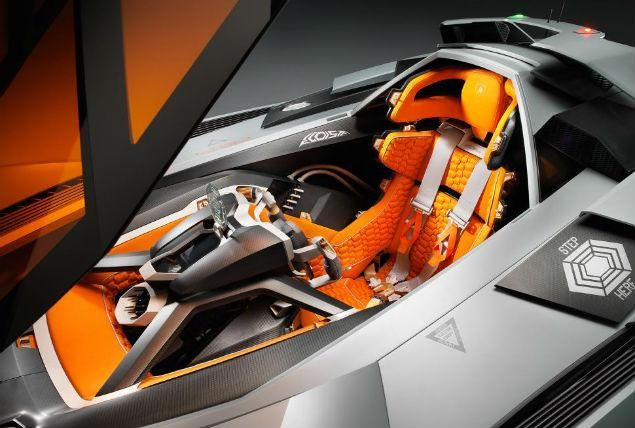 Inspired by the cockpit of an Apache helicopter, the Lamborghini Egoista cabin is completely customized to the car's driver. The orange glass canopy lifts up electronically, and the steering wheel can be removed to make it easier to get in or out of the car.