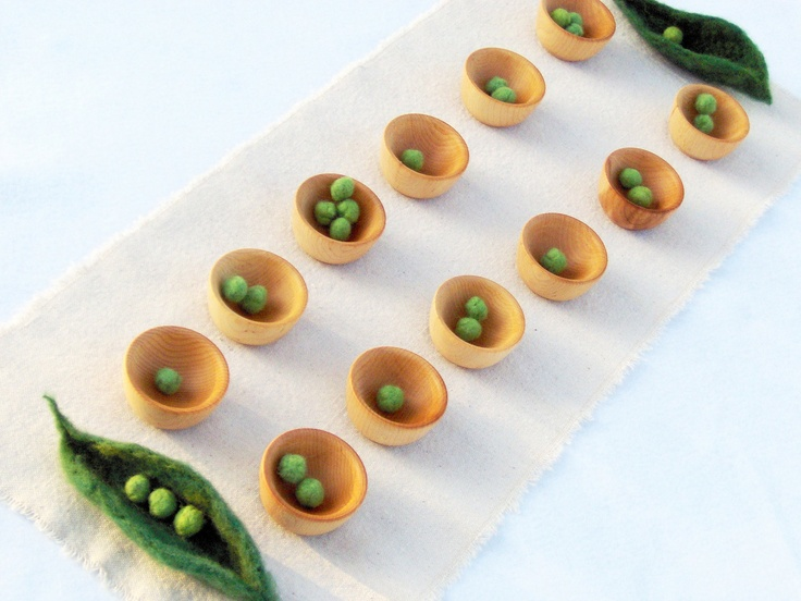 Peas in a pod mancala game and craft kit - wood, wool, and cotton. $38.00, via Etsy.