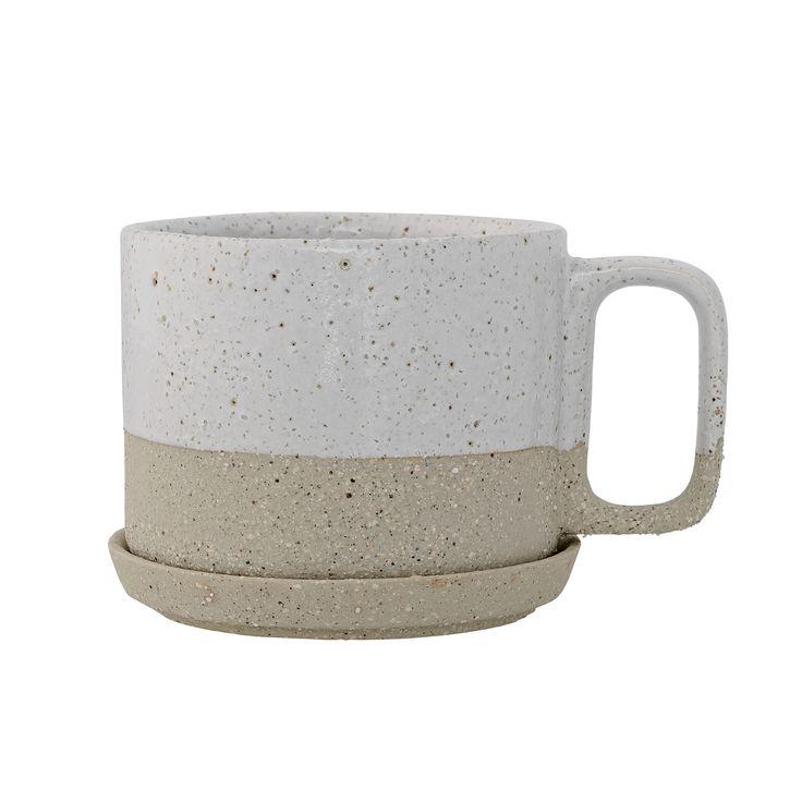 Barbara kop og fad fra Bloomingville. En traditionelt formet kop med tofarvet design som giver koppe...