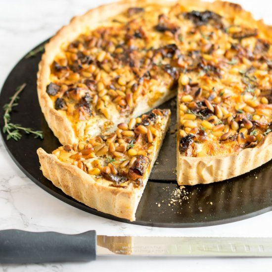 An autumnal quiche made with a light pizza dough base and filled with roasted squash and ricotta, topped with toasted pine nuts.