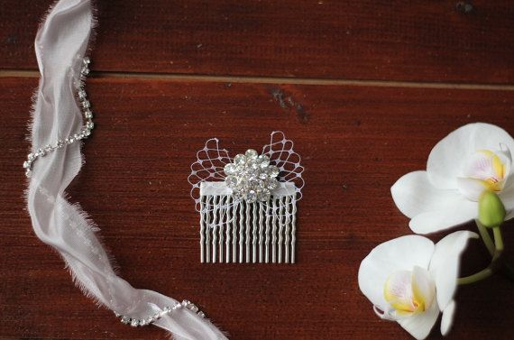 Rhinestone hair comb - this white bow headpiece features hand-sewn bow created using veiling and a large 30mm sparkly rhinestone. Very easy placement in your hair-do.  Stylish gift for a bride.  ~ Measurements: 6x5cm = 2.3x2 ~ Color: white ~ Orders are posted from Slovakia, Europe with expected delivery times of:  Within the Europe: 5-7 working days (by 1st Class Signed For Post) Outside the EU: 7-20 working days (by 1st Class Signed For Post) Upgraded priority services are available fo...