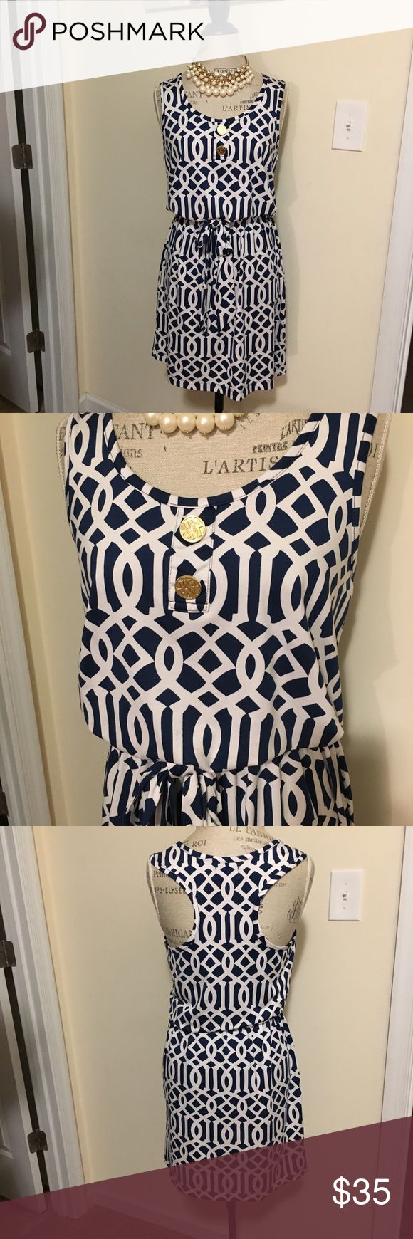 Mud Pie Blue White Dress Small w Tie Brand new without tags women's Mud Pie navy blue and white geometric design dress with matching waist tie. Available in a women's size small. Runs a little big for a small. Small to medium. Immediate shipping!! Mud Pie Dresses Midi