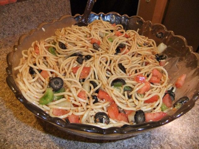 A 5-star recipe for Cold Spaghetti Salad made with vermicelli or spaghetti pasta, Italian salad dressing, red onion, tomatoes, cucumber