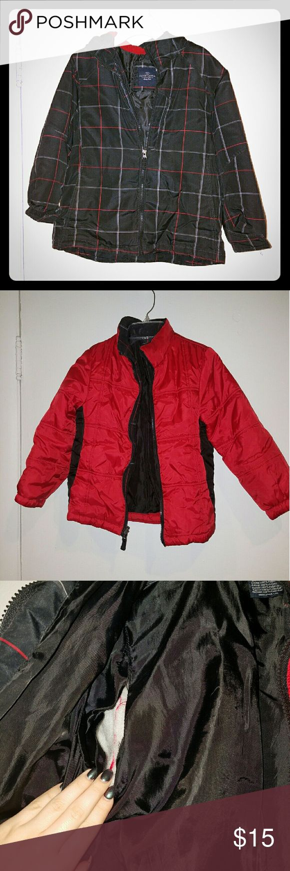 Boys winter coat. Boys double layer winter coat. Red jacket zips into the black one. Outer shell has a hood attached. There is a rip on the inside arm of the red coat, but this can easily be sewn. Brand is faded glory. Faded Glory Jackets & Coats Puffers