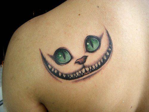 Tatouage du chat de Cheshire (Alice au pays des merveilles) on http://flepi.net