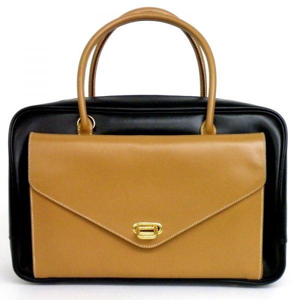 【中古】Hermes(エルメス) □C刻印 ロレーヌ ゴールド金具 ハンドバッグ ブラック ゴールド バッグ/ポーチとトラベルバッグの2つがドッキングしたように作られたバッグ「ロレーヌ」は異なる2種類のバッグの長所を生かしたデザインです。/新品同様・極美品・美品の中古ブランド時計を格安で提供いたします。