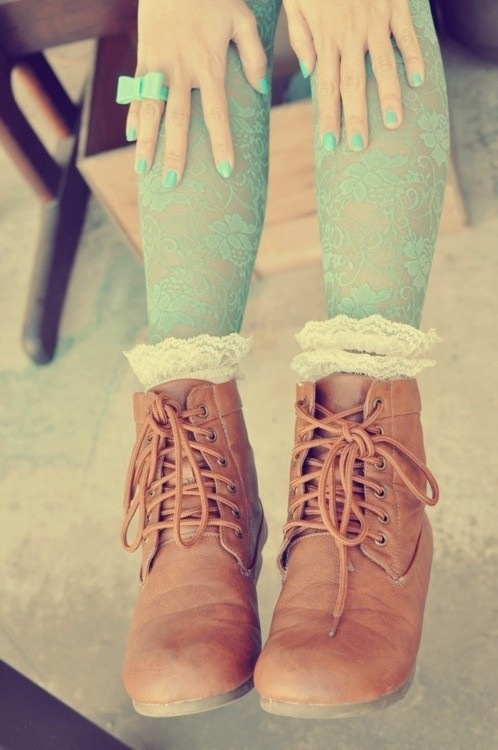 Combat boots, lace tights, bow ring and mint green nails.