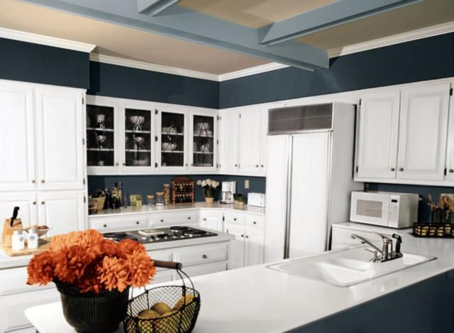 """30 Inspiring Paint Colors for Your Kitchen: A Very """"Moody"""" Blue and White Kitchen Paint Scheme"""