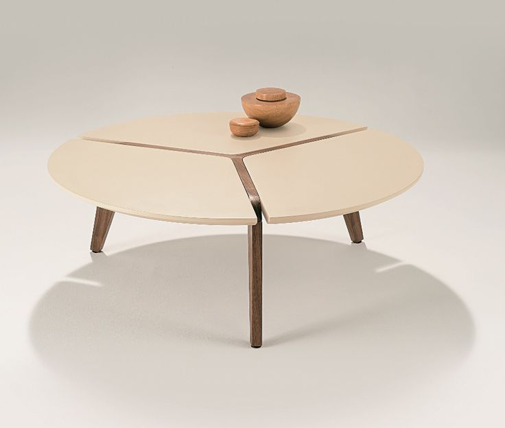 Puntara Coffee Table - sculpted and tapered legs in walnut finish, combining with matt lacquer top in latte colour
