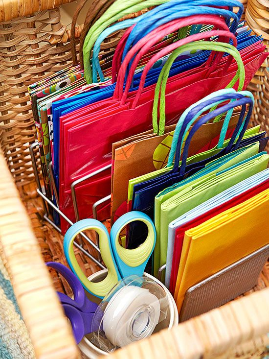 Use Space You Can't See.  Under a bed, or open storage can storm items that don't have a space elsewhere.  A wicker basket gathers oddly shaped gift bags and other wrapping supplies