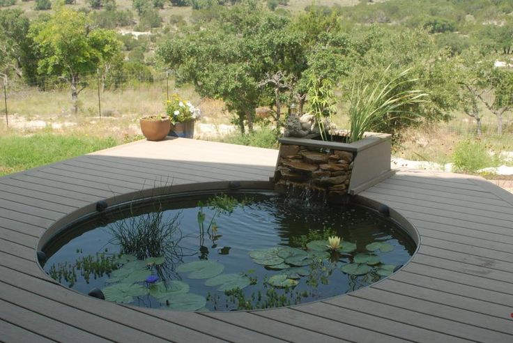 Small koi pond design ideas garden design modern small for Circular garden decking