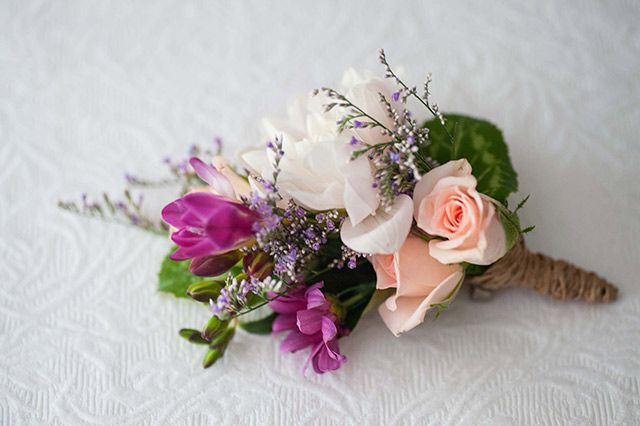 A mix of pink and purple flowers. Image: Solas Wedding & Portrait Photography