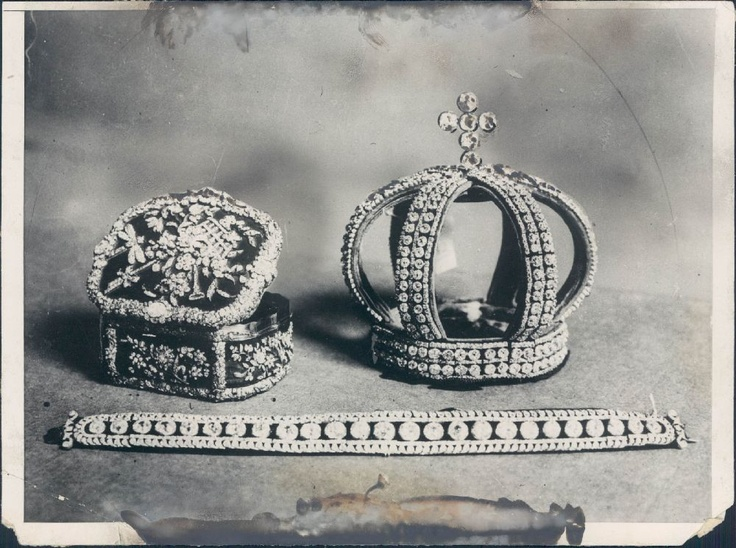 Photo of Russian jewels including The Nuptial Crown/Coronet of the Romanov Brides. This crown, made from sections of a diamond belt was used by members of the Romanov Imperial Family to adorn the head of their brides. It was worn at the back of the head in conjunction with the Pink diamond Tiara which was worn above the brow. It came to America after it was purchased by a collector at the famous sale of the Imperial Jewels by the Communist Government after the Russian Revolution.