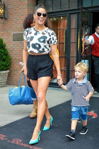 Paula Patton holds the hand of her son, Julian Fuego Thicke, as she exits a building in downtown Manhattan.