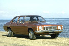 Holden HX Kingswood.  Next came the Kingswood!  Ours was the Vacationer, gold with white leather seats. Family car!