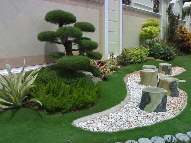 jardin de rocaille avec gazon et cailloux