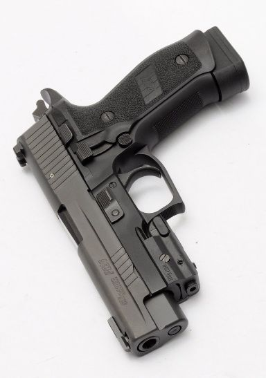 Best hand gun i have ever owned! Sig Sauer P226 TACOPS 9mm 20rd