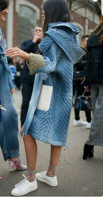 Fashion Week Street Style Light Blue Over-Sized Puffa Inspired Coat With White Sneakers And Sheer Spotted Socks