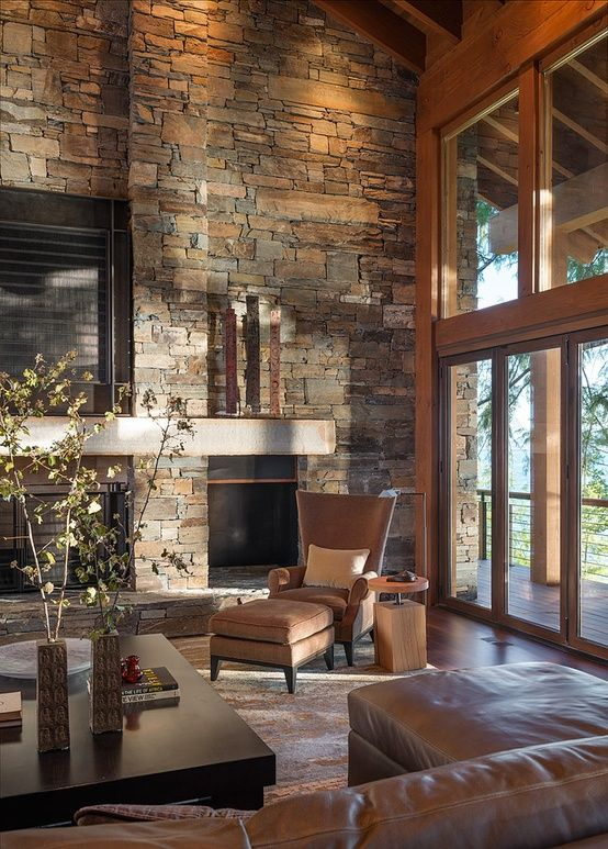 Living Room - Living with a textured stone wall, full fireplace and floor to ceiling glass....easy on the eyes.....yes!