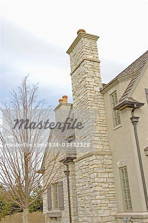 EXTERIORS: Close Up Architectural Detail Of Outdoor Chimney, French  Normandy Style Home Of Stone And Stucco With Shutters, Stone Chimney And  Terra Cotta ...