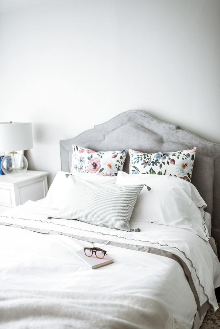 floral pillows on bed
