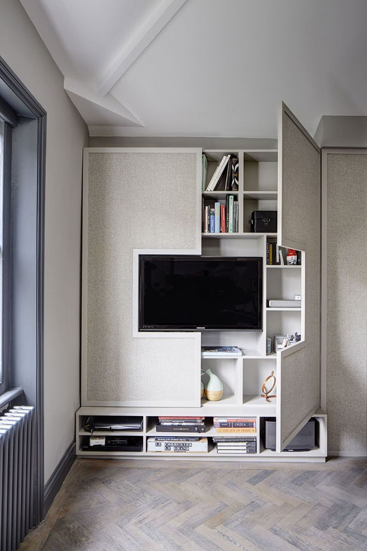 Perfect TV Wall Design Idea   Hide Shelves With Large Custom Made Cabinet Doors