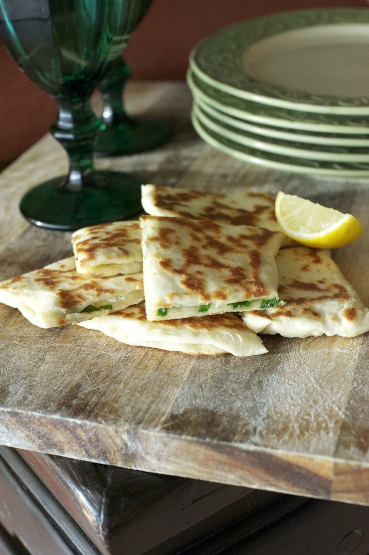 Spinach & Feta Gozleme MAKES 4 (1 per person is a light lunch) Ingredients 250g self raising flour 220g full fat natural greek yoghurt 1/2 teaspoon salt Extra flour for dusting Olive oil 2 cups chopped spinach 1 cup crumbled feta