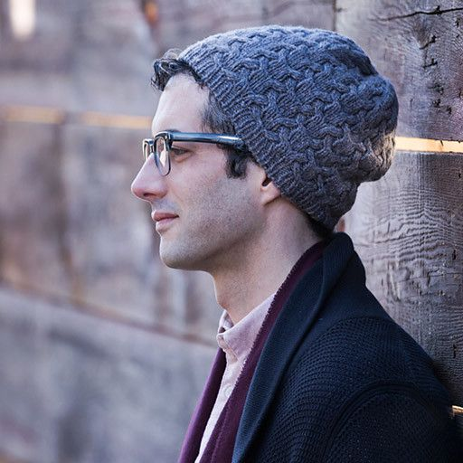 """Crag is an all-over cabled cap with plenty of interest. The plump stitches won't get lost in darker colors, so it works in every color! SIZING: 21¾"""" circumference (to fit 20–23″ head); 9¼"""" length YARN"""