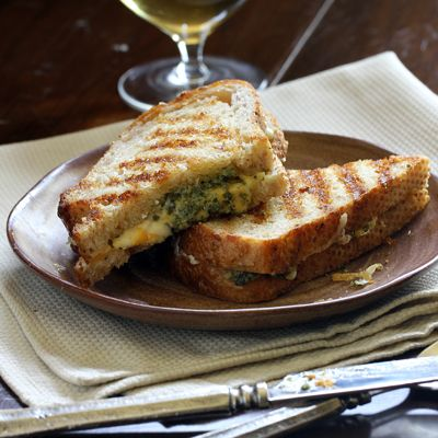 Ooey-Gooey Take on the Classic Comfort Food: Pesto Grilled Cheese Sandwiches. Easy family dinner! And goes great with white wine.