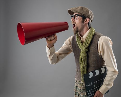 Film director shouting via old fashioned megaphone