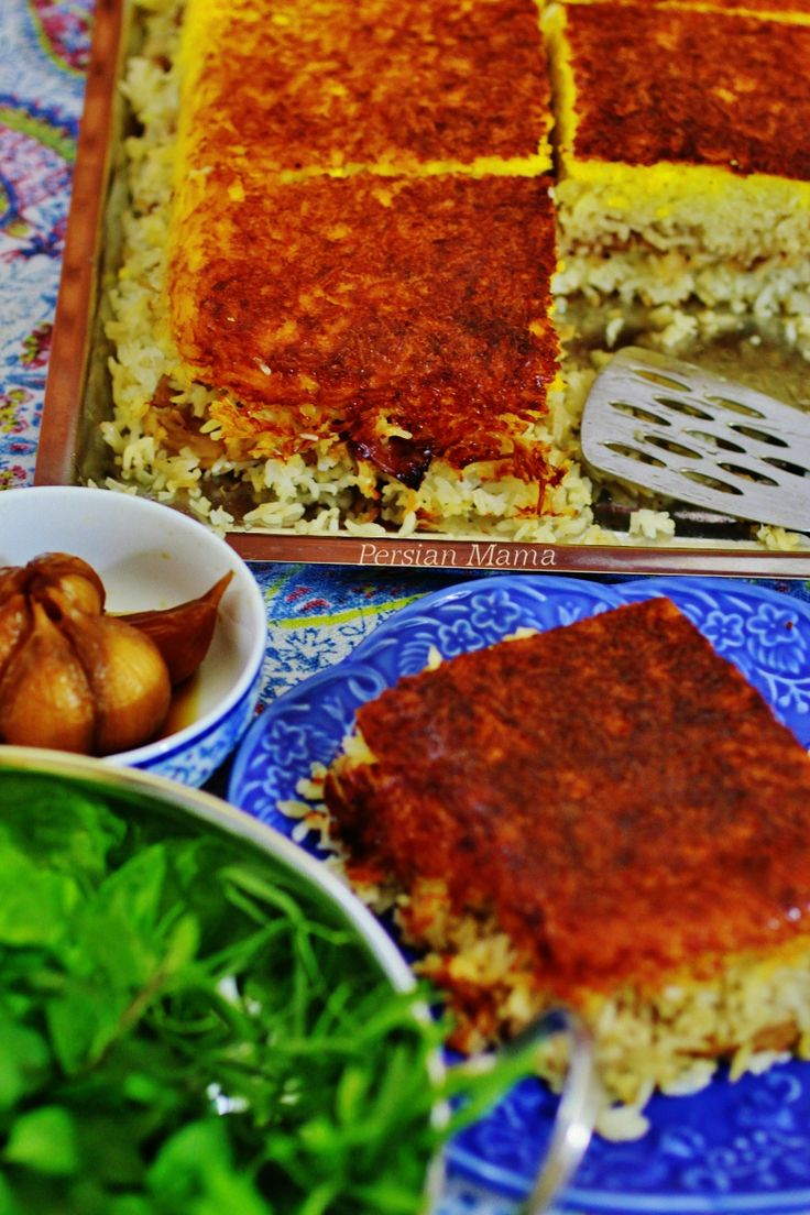 Tahchin Morgh is a Persian dish with tender chicken in the layers of baked basmati rice with a crispy golden TahDig all in one dish