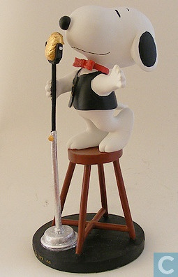 Snoopy crooning at a microphone.