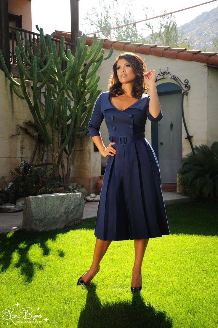 Ashley Dress in Navy Sateen - The Ashley is a classic 1950s coat dress style with modern comfort and the famous Pinup Couture fit.  Featuring a flattering, wide notched collar, faux buttons, three-quarter sleeves, and a pleated skirt.  If your pleats don't stay as pressed as you'd like, a warm iron to press them back into place will work well.  Finished off with a removable belt and a back zip.