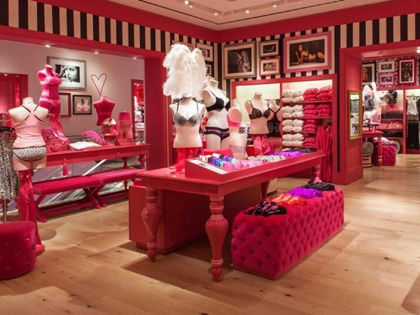 victorias secret store . . . the inspiration of my new house . . . Black & white stripes!! Hot pink mouldings and baroque & Hot pink tufted furniture.