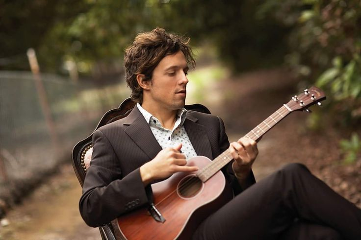 Jason Mraz, just sitting in the middle of the road playing his guitar, you know....like he does.  Get two free tracks to go with this pic: www.dylangalvinmusic.com