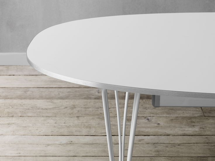 Fritz Hansen - Table Series™ have been enhanced through a new laminate, a surface that is highly resistant to scratches - which has a low reflection of light, opaque surface that's easy to clean and that does not show marks like fingerprints.