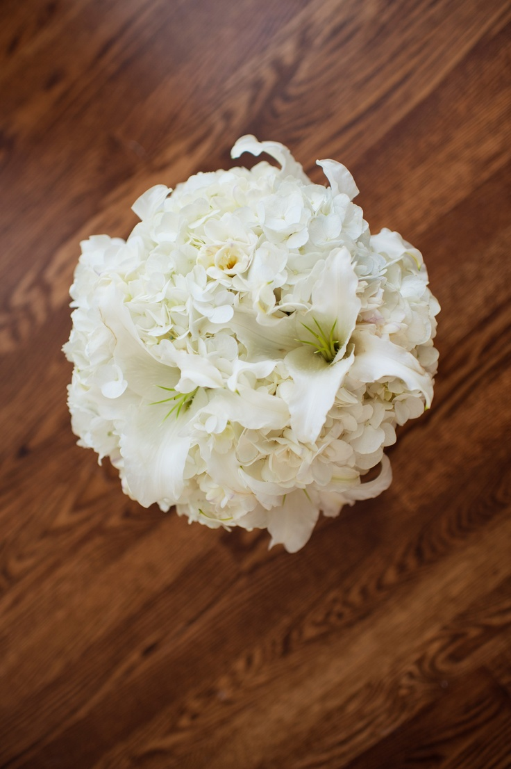 White bouquet with hydrangea, lily, and freesia.