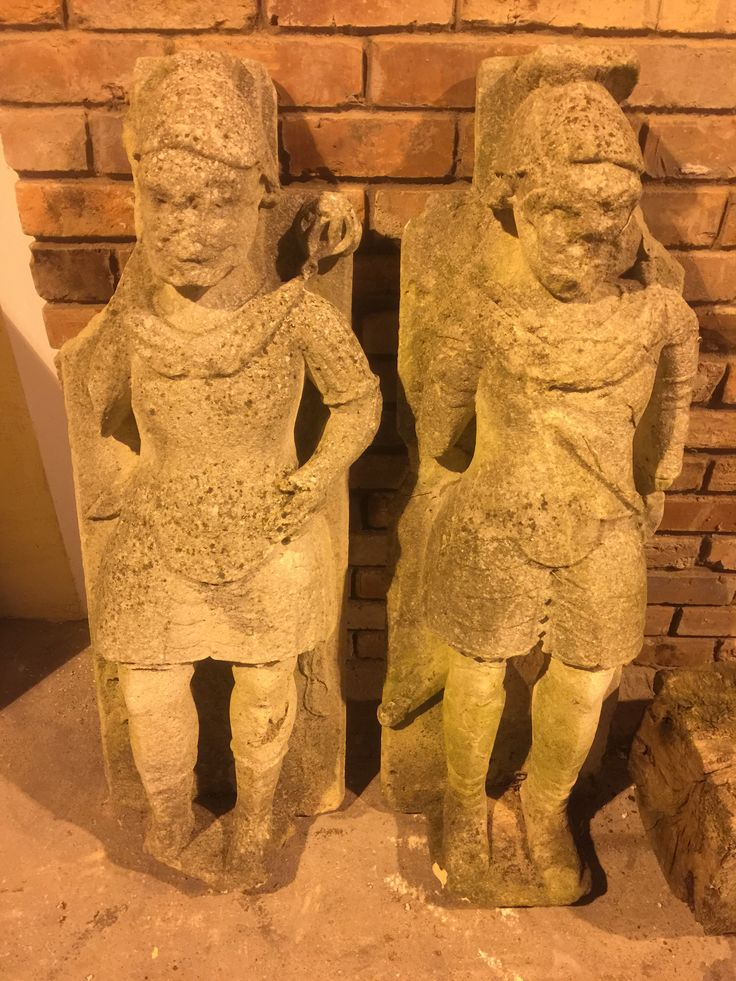 16th century limestone figures in the form of Roman soldiers