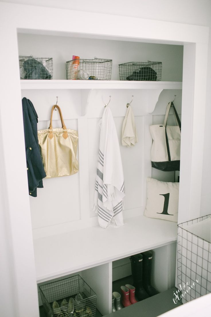 DIY closet converted into a mudroom with painted concrete floors and lots of pretty and practical ideas to get organized!