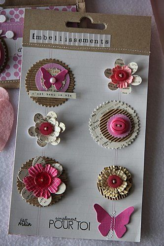 cute layered embellies. corregated paper, buttons, flowers, butterflies embellishments to cut and save for scrapbooking later