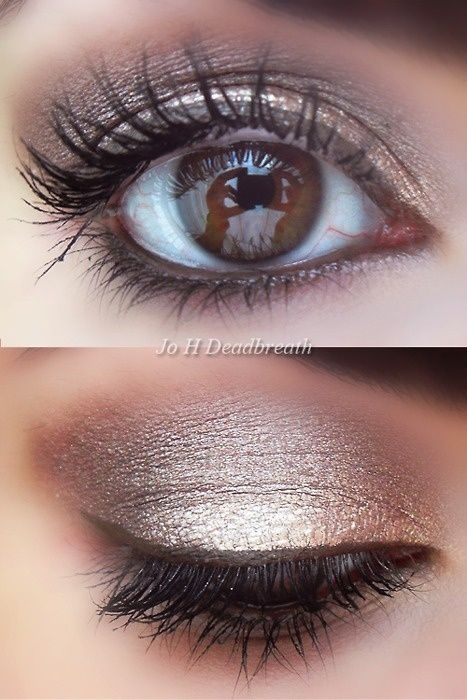 Matte ashy dark brown in the crease. White or ivory shimmer dabbed on lid, blended upward into the crease. Line upper lid thinly with a dark brown eyeliner. Smudge a dark brown kohl pencil on bottom lid. Curl lashes and add dark brown
