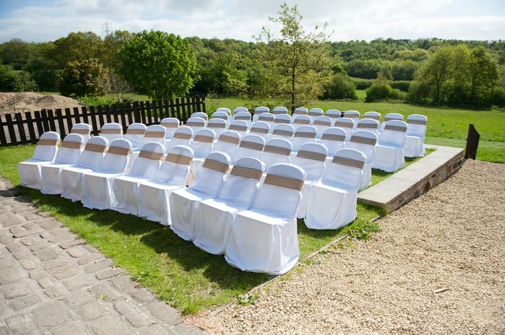 Rustic burlap wedding chair covers - http://www.luxeinlove.co.uk/. Outdoor wedding ceremony UK. Photo by http://www.kimfoleyphotography.com/