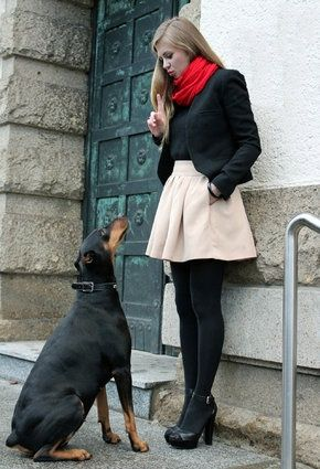 Khaki A Line Skirt. Black Blouse. Red Infinity Scarf. Black Tights. Black Heels.