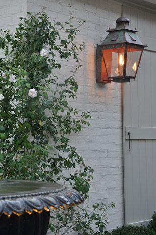 light grey painted brick exterior - authentic gas lantern