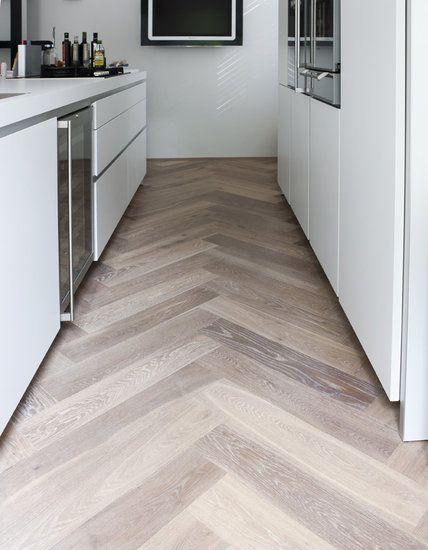 Wood look tile set in a harringbone pattern