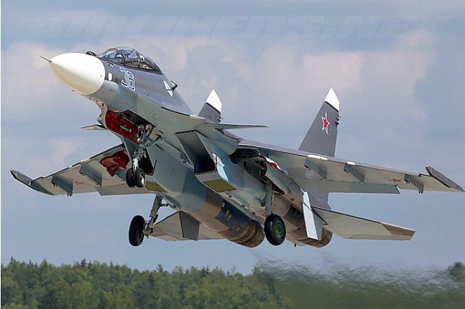 A Russian Air Force Sukhoi Su-30SM flairs its nose up to land.