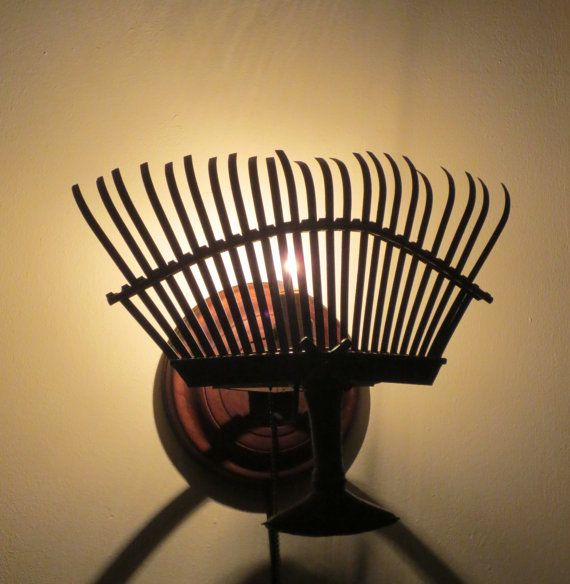 The Rake's Progress plug-in sculptural wall sconce by 4fLighting