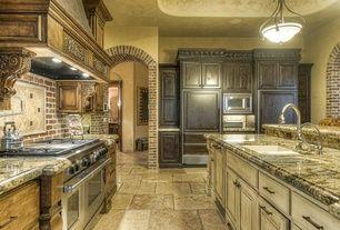Mediterranean Kitchen with Framed backsplash, Pot filler faucet, Stone Tile, Inset cabinets, Kitchen island, L-shaped
