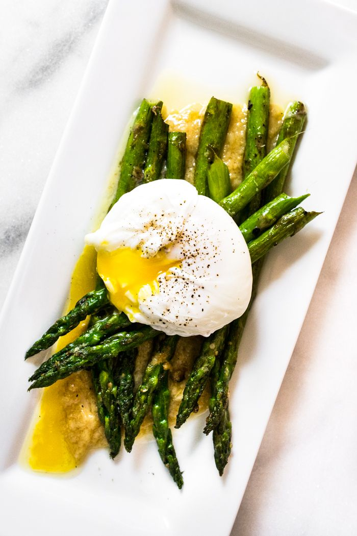 Brunch is served! Some days simplicity is best: a short list of ingredients and a few flavors that work wonderfully together. Serve with a toasted English muffin, an oven fresh biscuit, or some breakfast fried rice. | Asparagus with Poached Egg and Roasted Garlic Miso Butter