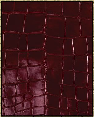 European full grain vegetable-tanned aniline-dyed cowhide; hand-antiqued leather that is available in 15 different colors. I think this leather would make a nice ottoman or arm chair.